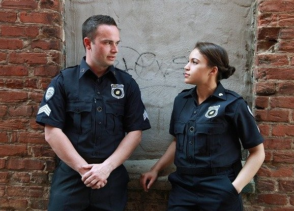 Male & Female Police Officers talking