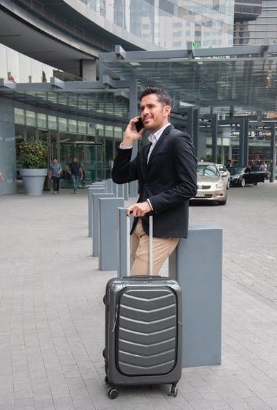 Business man waiting outside airport